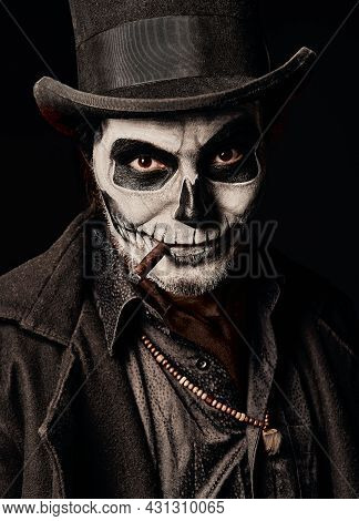 A Young Man In Image Of Baron Samedi, The Voodoo Deity. Baron Saturday Dressed In Black Coat And Top