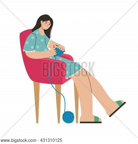 A Girl Knits Clothes In A Chair. Creative Activity.