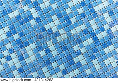 Blue Ceramic Mosaic In The Pool. Laying Small Tiles In The Pool. Close-up Background. Construction W