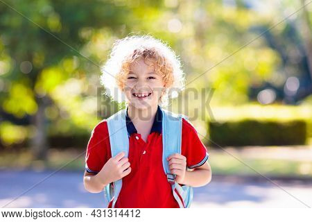 Children Go Back To School. Start Of New School Year After Summer Vacation. Boy And Girl With Backpa