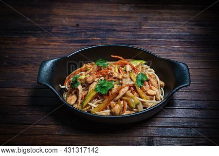 Asian Style- Restaurant Background. Udon Noodles With Beef Wok
