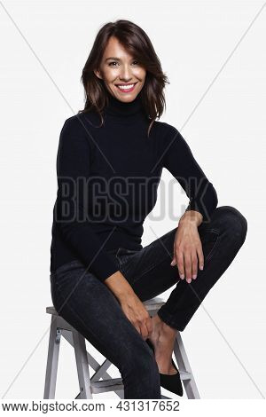 Beautiful Smiling Woman With White Teeth Sitting At Isolated White Background. Happy Woman Wearing T
