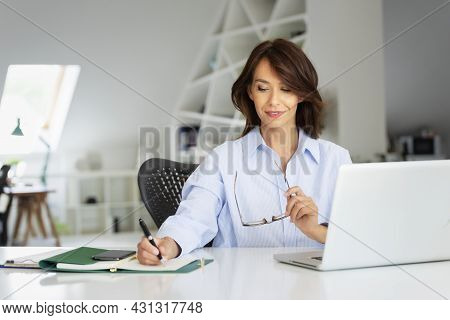Confident Middle Aged Businesswoman Working At The Offfice