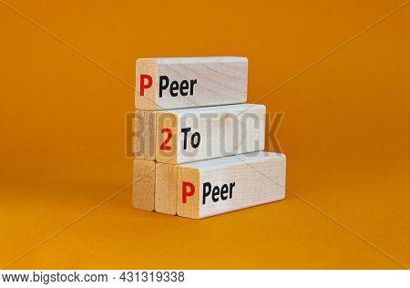 P2p, Peer To Peer Symbol. Wooden Blocks With Concept Words 'p2p, Peer To Peer'. Beautiful Orange Bac