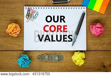 Our Core Values Symbol. Words 'our Core Values' On White Note. Wooden Table, Colored Paper, Paper Cl