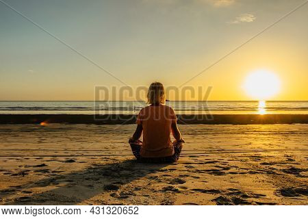 Girl Sitting On Beach And Meditating To Calm Her Mind.evening Relaxation By Sea.intended Female Tran