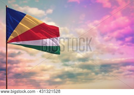 Fluttering Seychelles Flag Mockup With The Place For Your Text On Colorful Cloudy Sky Background.
