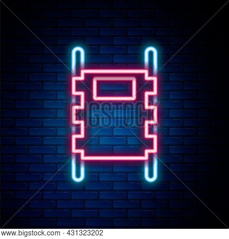Glowing Neon Line Stretcher Icon Isolated On Brick Wall Background. Patient Hospital Medical Stretch