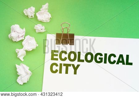 Ecology Concept. On A Green Background, Crumpled Paper And A Sheet With The Inscription - Ecological
