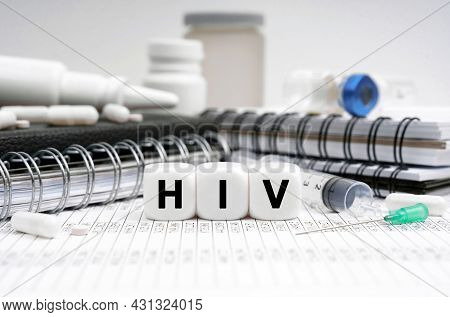 Medicine Concept. On The Table Are Diaries, Medicines And Cubes With The Inscription - Hiv
