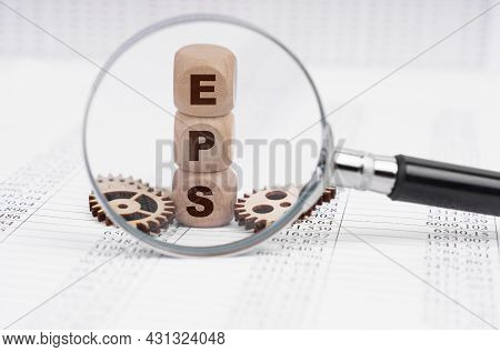 Business Concept. There Is A Magnifying Glass On The Documents That Points To The Cubes With The Ins