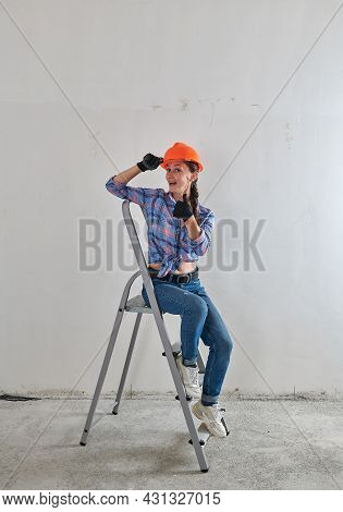 Repairman Sitting On The Stairs In Jeans