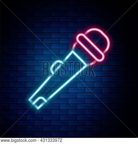 Glowing Neon Line Microphone Icon Isolated On Brick Wall Background. On Air Radio Mic Microphone. Sp