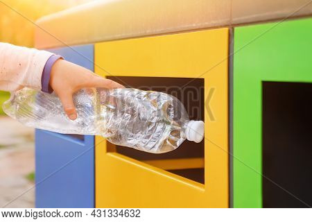 Close Up Hand Throwing Plastic Bottle Recycling Container Garbage Sorting Rubbish Collection Bin. Ha