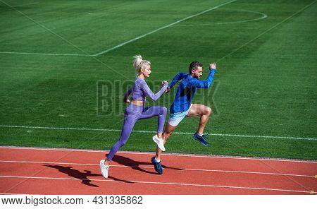 Sport. Marathon Speed. Sport Couple Run Fast To Win. Successful Fitness Sprinters.