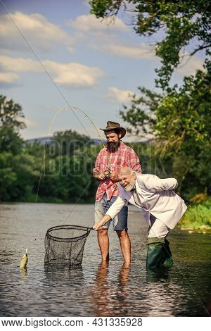 We Can Do It. Catching And Fishing Concept. Two Male Friends Fishing Together. Fly Fish Hobby Of Bus
