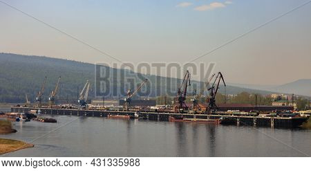 Central Cargo Area Of The Osetrovo River Port On The Lena River In The City Of Ust-kut In Summer. Mo