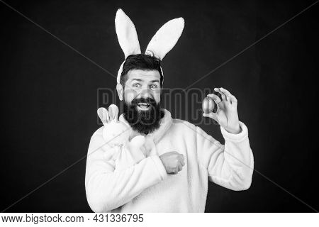 Paschal Egg. Comic Hipster With Rabbit Ears Holding Bunny Toy And Egg. Bearded Man In Rabbit Costume