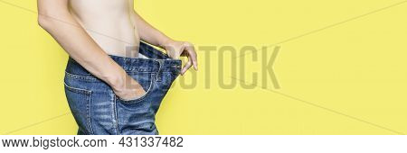 Concept Of Diet, Proper Nutrition, Weight Loss Slim Woman Showing Loose Jeans And Her Loss Weight. W
