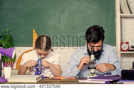 Study Hard. Following Example. Girl Pupil Study With Bearded Teacher. Studying Methods For Children.