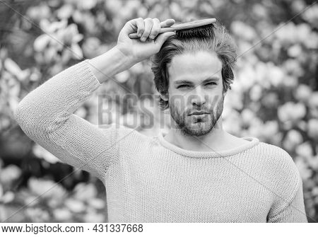 Beautiful Hairstyle. Hipster Enjoy Blossom Aroma. Spring Beauty. Hairdo Styling. Man Flowers Backgro