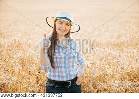 Smiling Woman Farmer With Hat Showing Thumb Up And Looking At Camera Standing Farmland Smiling Femal