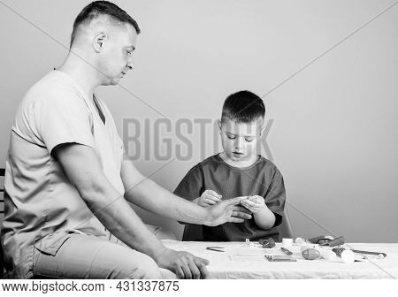 Small Boy With Dad In Hospital. Father And Son In Medical Uniform. Happy Child With Father With Stet