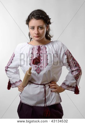 Resolute Ukrainian Girl With A Rolling Pin
