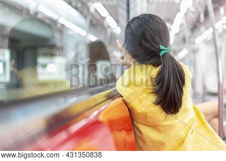 Girl Looking Out Train Window Outside, While It Moving. Child Wear Facemask During Coronavirus And F
