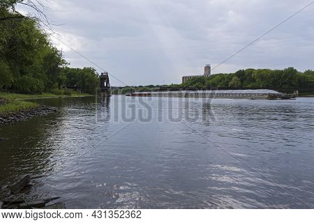 Barge Vessel Passes Through Swing Bridge Opening On Missisisippi River At Lilydale Minnesota