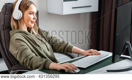 Young Woman Freelancer Busy Working Remote From Home Using Pc Computer In Living Room Interior. Casu