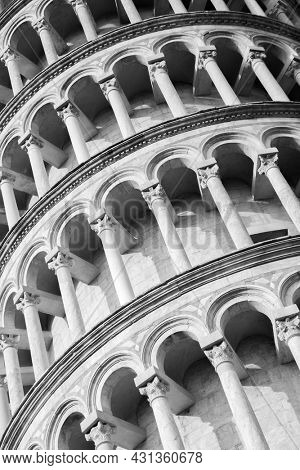 Tiers of The Leaning Tower of Pisa close-up, Italy. Black and white architectural photography