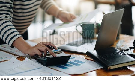 Close Up Accountant Working On Desk Using Calculator For Calculate Finance Report At Home Office