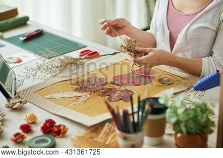 Hands Of Woman Decorating Oshibana Style Artwork With Flowers Made Of Flax Rope