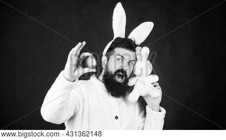 This Easter Egg Is Perfect. Happy Man With Rabbit Ears Holding Bunny Toy And Egg. Spring Holiday. Be