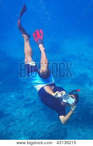 Photographer making photo underwater in the Andaman sea of Thailand
