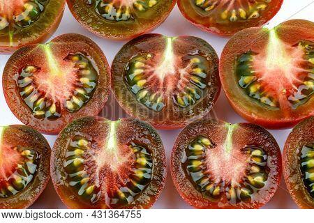 Black Tomatoes Cut Into Halves. Black Tomatoes. Cumato Tomatoes. Tomato Background.