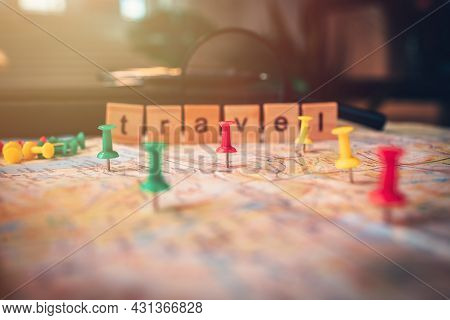 Pins Pinned On The Map. Pushpin Showing The Location Of A Destination Point On A Map. Travel Plan Co