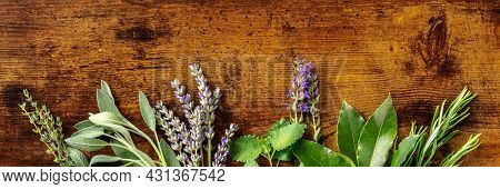 Aromatic Herbs Panoramic Banner With Copy Space, Shot From The Top On A Rustic Wooden Background. Bu