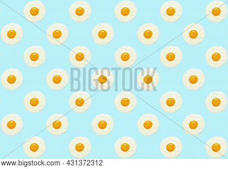 Egg Minimal Background. Fried Chicken Egg For Breakfast On A Blue Colored Pattern Background. Creati