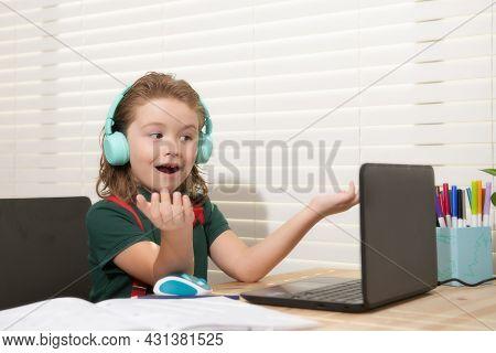 Caucasian School Boy In Headphones Have Video Call Distant Class With Teacher Using Laptop, Happy Sm
