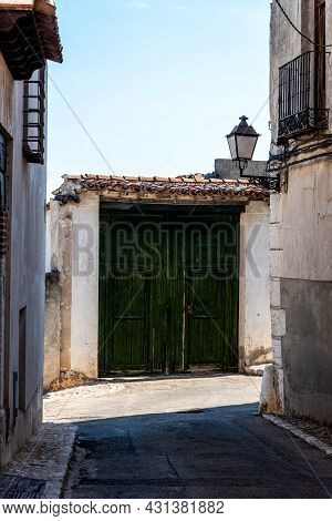 Green Painted Wooden Doorway In The Historic Center Of A Village
