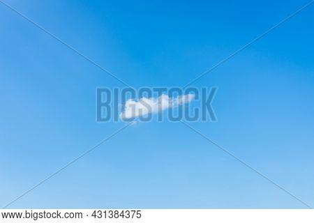 Blue Sky One Alone White Cloud Scene.beautiful Sparse Cloud In The Blue Sky.white Cloud In Clear Blu
