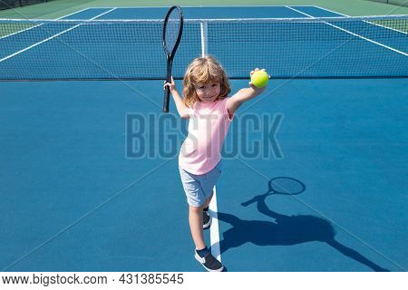 Child Boy Playing Tennis On Outdoor Court. Little Girl With Tennis Racket And Ball In Sport Club. Ac