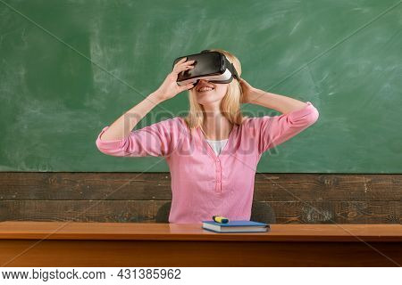 Student Reading With Vr Glasses On A Blackboard. School Girl With Virtual Reality Headset. Education