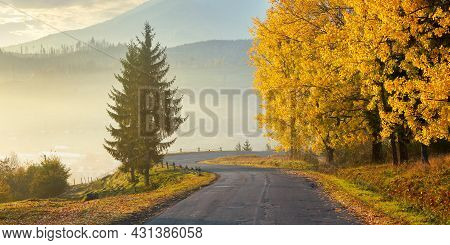 Countryside Mountain Road At Sunset. Trees In Colorful Foliage Along Serpentine. Beautiful Scenery I