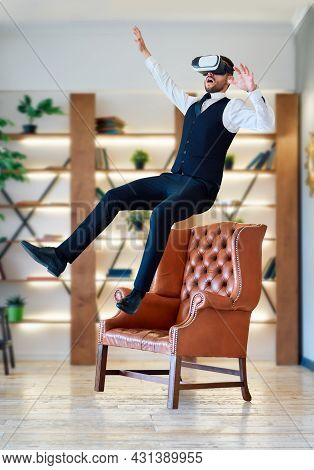 Man Wearing Virtual Reality Goggles Levitating In Air.