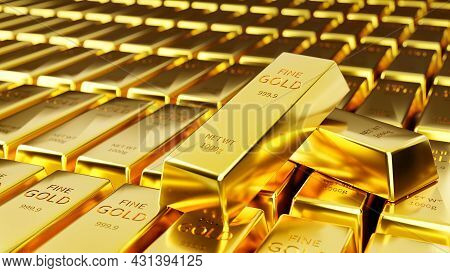Two Stabs Of Gold Were Stacked Against The Background