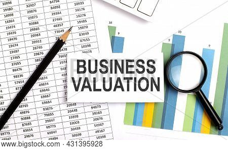 Business Valuation Text On White Card On Chart Background