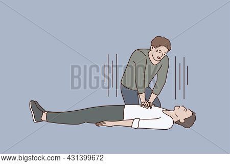 First Aid And Heart Massage Concept. Young Stressed Man Sitting On Knees Making Heart Massage To Lyi